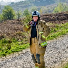 Smiling female firefighter on Ilkley Moor
