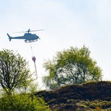 Helicopter drops a water bomb on Ilkley Moor fire