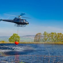 Fire fighting helicopter collects more water from Panorama Reservoir near Ilkley