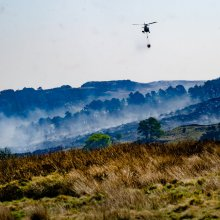 Helcopter drops more water bombs on the Ilkley Moor fire